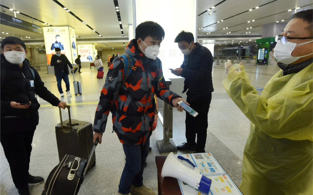 Travelers show their QR Codes to access public areas in China