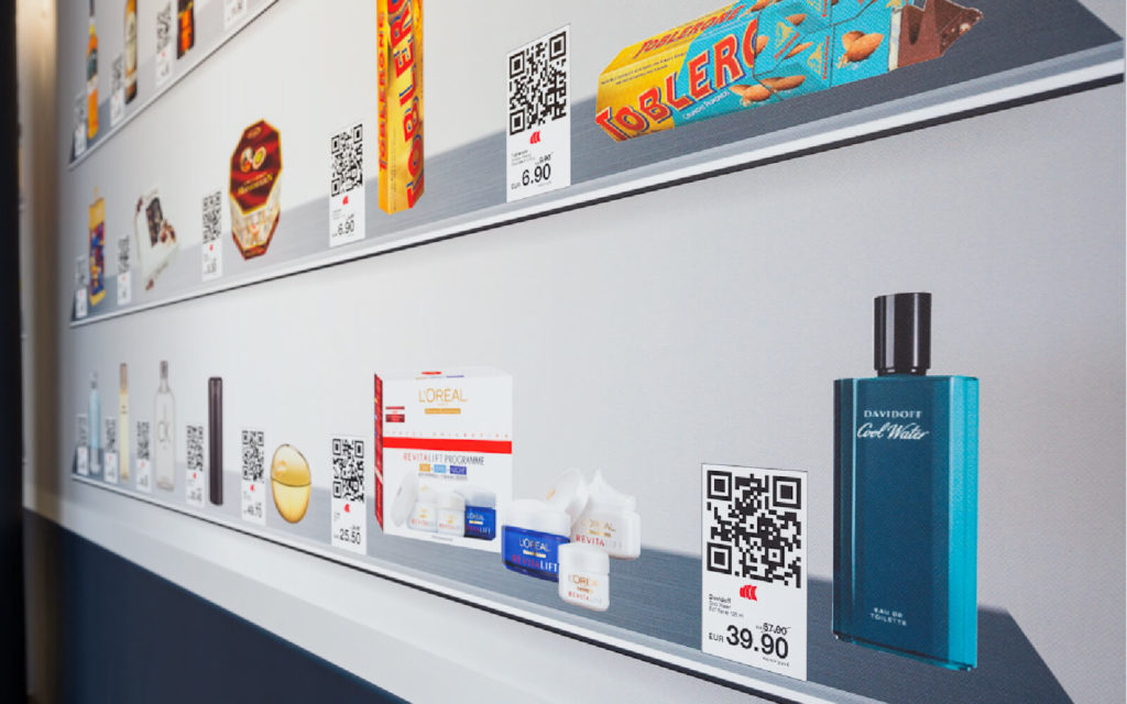 QR Codes on an airport wall add give passengers an additional shopping opportunity