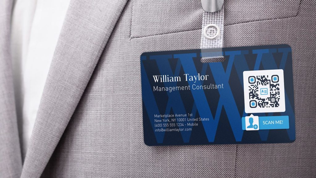 Business card name tag with a VCard QR Code sharing contact details.