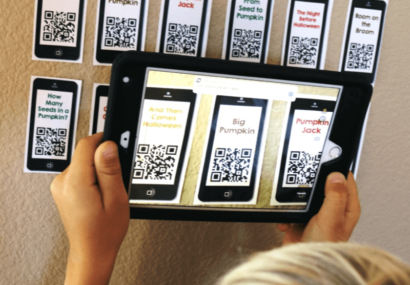 A child scanning QR Codes with an iPad
