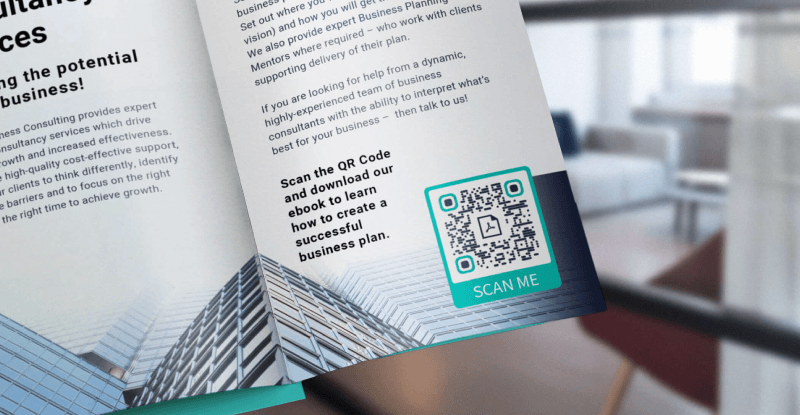 QR Code on a brochure prompts readers to scan to download an eBook to learn how to create a successful business plan