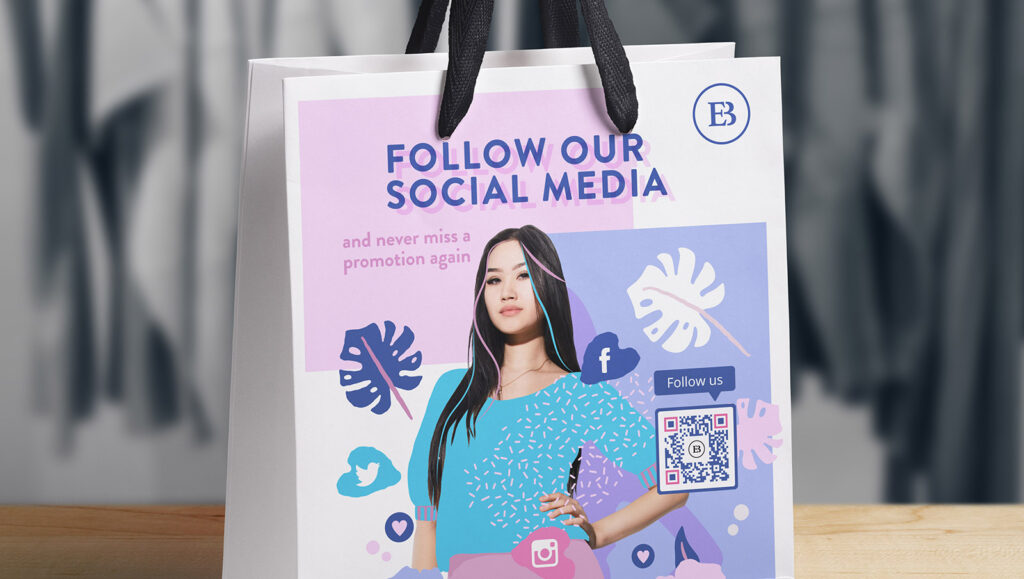 Social Media QR Code on a boutique's shopping bag prompting customers to scan the code and follow them on social media