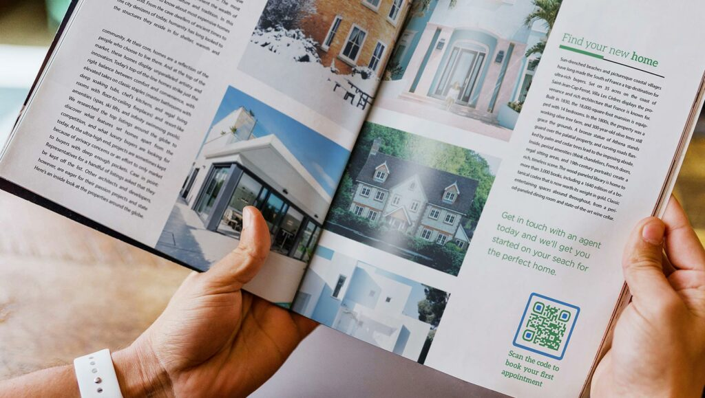 Business Page QR Code in a real estate brochure prompting readers to scan and book their first appointment