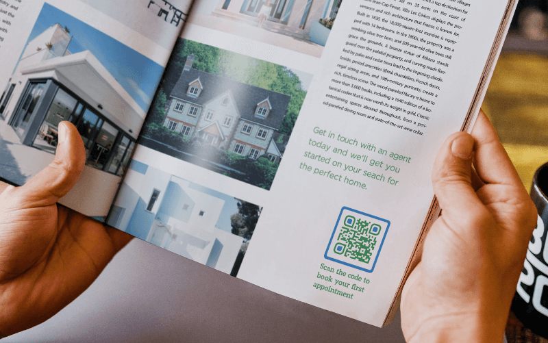 QR Code in a real estate agency's magazine ad prompting readers to scan to book an appointment