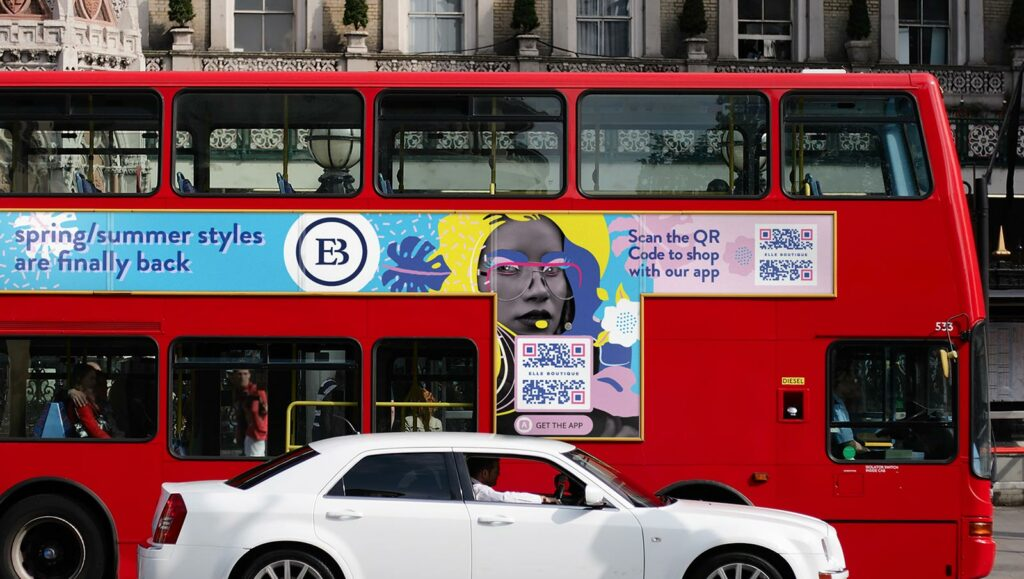 A boutique's App QR Code on a bus prompts people to scan to shop with their app