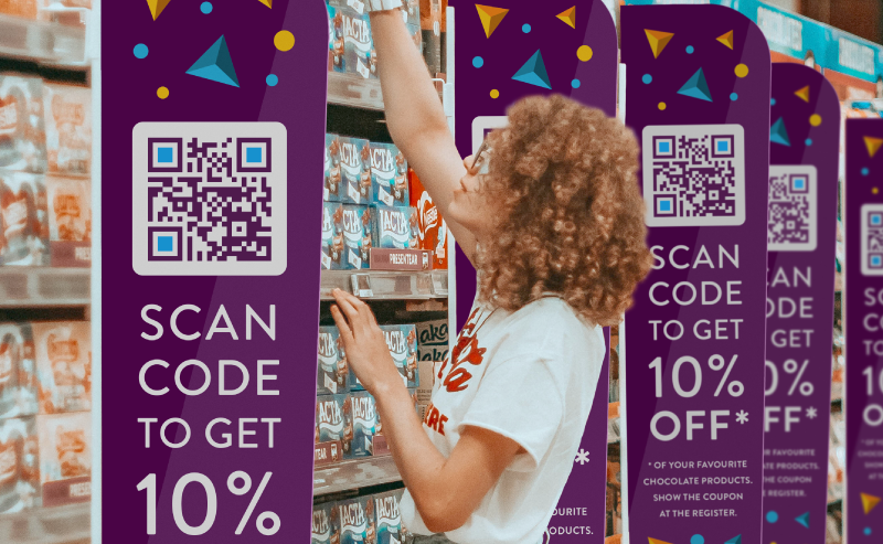 Coupon QR Code on product display sign prompting people to scan and receive 10% off their favorite chocolate