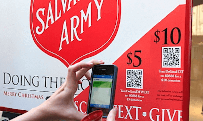 A QR Code on a non-profit donation display prompts people to scan and make a donation from their phone