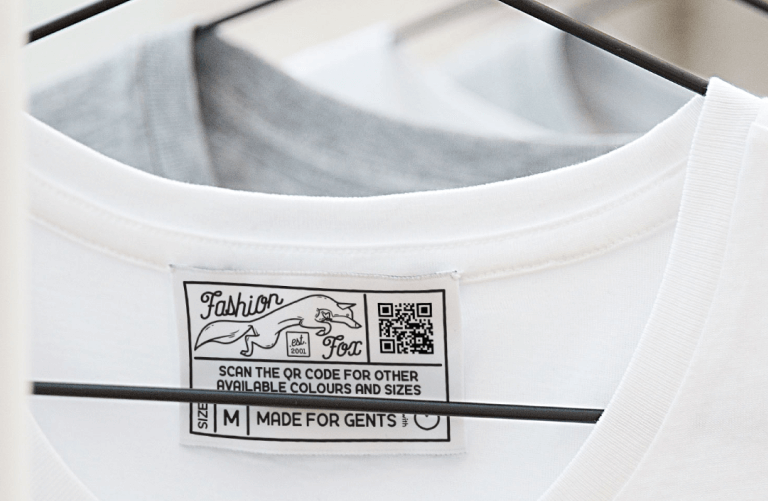 QR Code on a clothing label prompting people to scan for other available sizes and colors