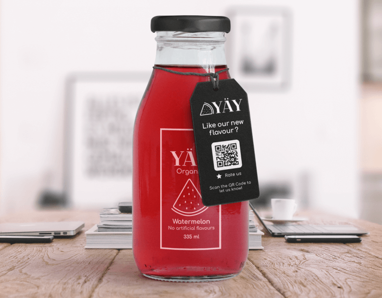 Rating QR Code on a juice product packaging prompting buyers to scan and rate the new flavor