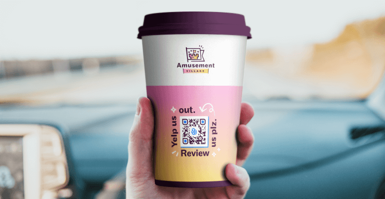 Dynamic URL QR Code on a to go coffee cup prompting the buyer to scan and review them on Yelp