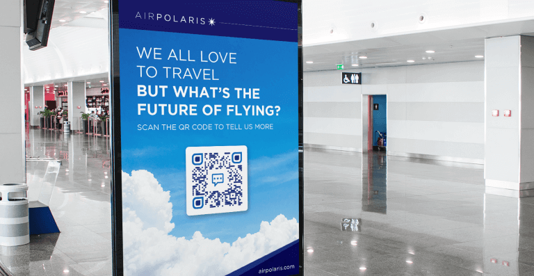 QR Code on a digital sign at a mall prompting visitors to scan and give feedback about the future of flying