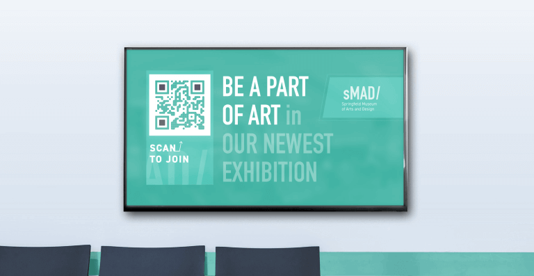 QR Code on digital signage prompting people to scan and join a new art exhibit