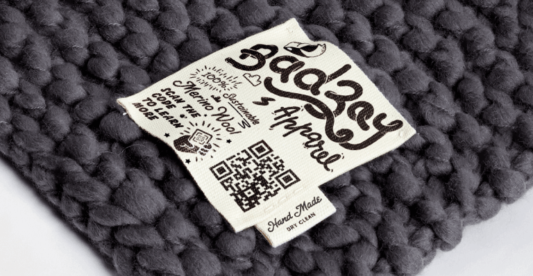 QR Code on a merino wool blanket prompting people to scan to learn more